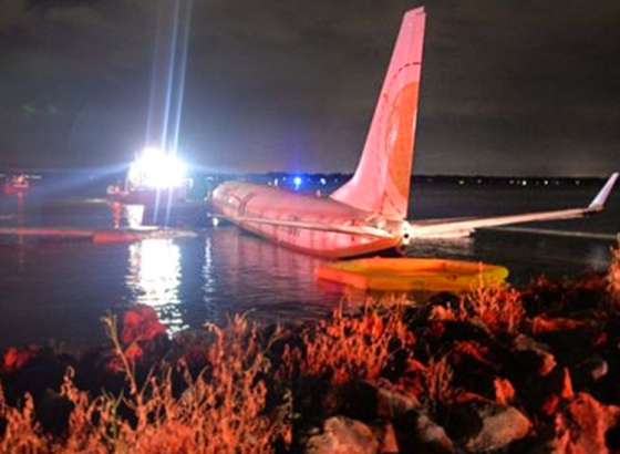 Boeing 737 aircraft slides off runway into river