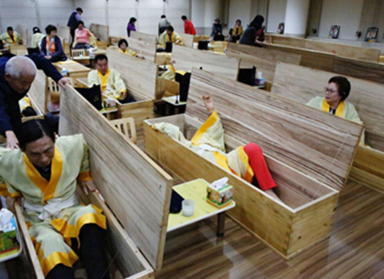 Thousands perform fake funeral in South Korea